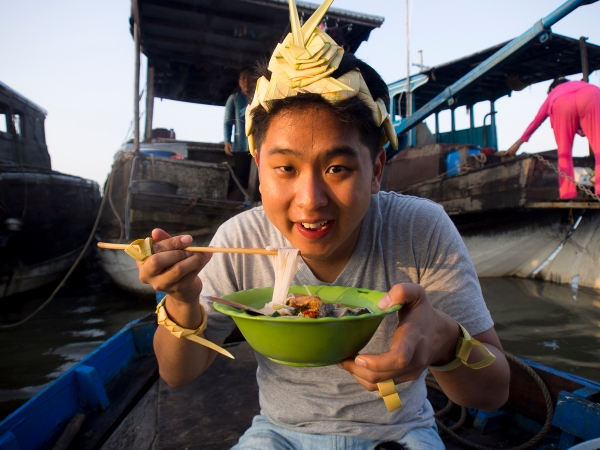 Enjoying a Bowl of Hu Tieu on the Mekong Delta... Priceless.