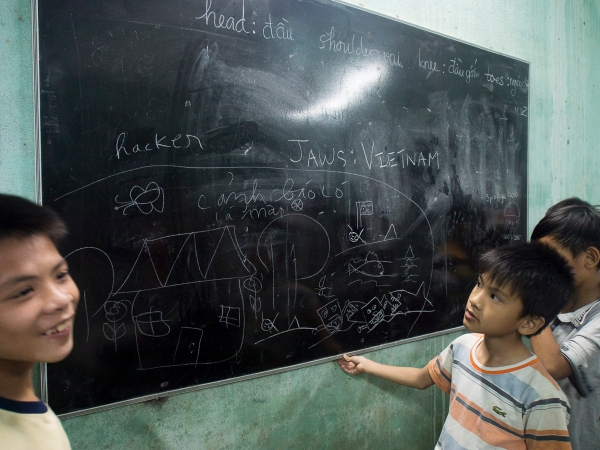 Children Having Fun With The Chalk