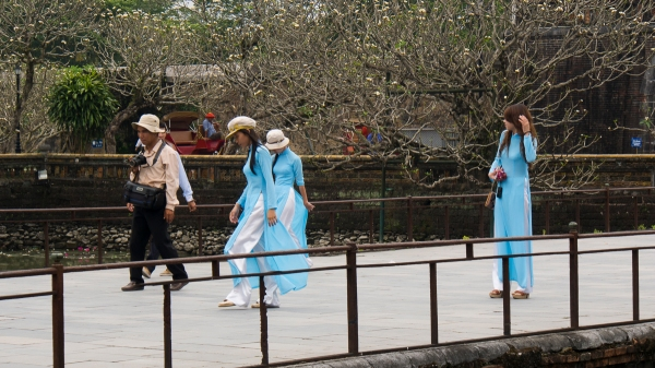 Locals in their Traditional Ao Dai Costumes